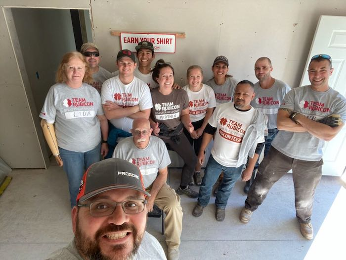 "Caroline Beightol of Procore, and her team of ""Greyshirts"" from Team Rubicon"